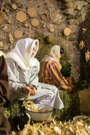 Canale, Italy - December 26, 2015: As every year the medieval town becomes a living Nativity scene. Next to the shepherds and the Holy Family revived ancient crafts and customs of the past.