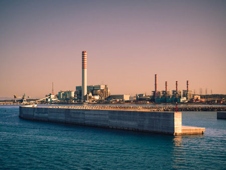 Civitavecchia, Italy - August 27, 2017: The ENEL Tower of Torrevaldaliga Nord is a coal-fired power plant with a total capacity of 1980 MW.