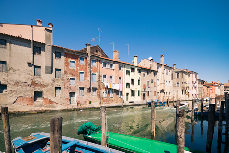 Characteristic canal in Chioggia, lagoon of Venice, Italy.