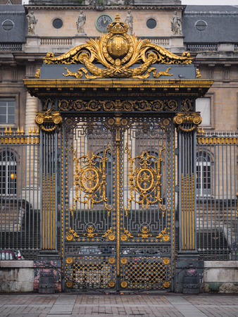 Golden gate of Palace of Justice in the Cite Island in central Paris in France.