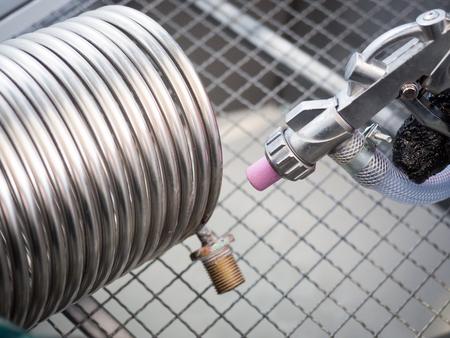 Sandblasting of a heat exchanger inside a special sandblasting cabin.