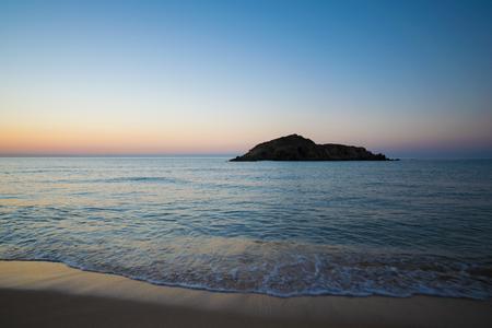 Su Giudeu island at sunrise, Chia, Sardinia, Italy.