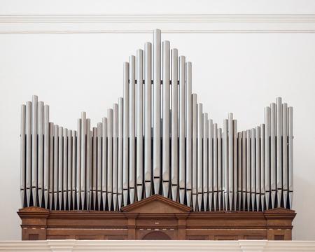 Organ above the entrance of an italian church. Stock Photo