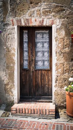 Old wooden door in a medieval village. Foto de archivo