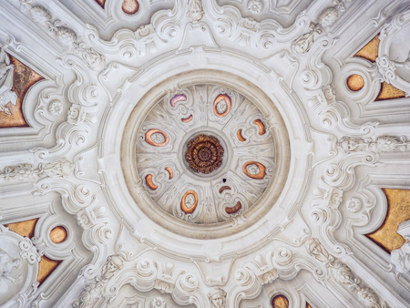 Parma, Italy - April 8, 2018: White stucco ceiling sculpted inside a votive chapel. Editorial