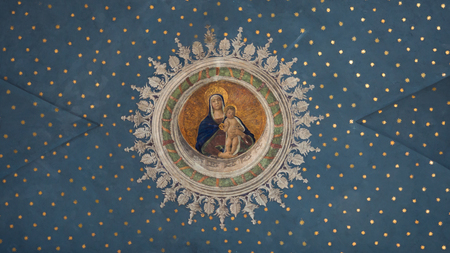 Montagnana, Italy. May 20, 2018: Virgin Mary with child Jesus painted on the starry ceiling inside the Gothic-Renaissance cathedral.