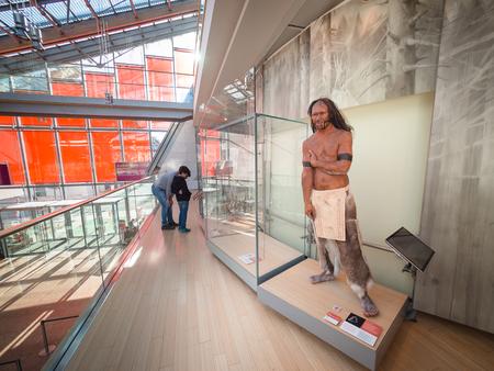Trento, Italy - November 11, 2017: Wax statues of primitive man at the science museum of Trento, Italy.