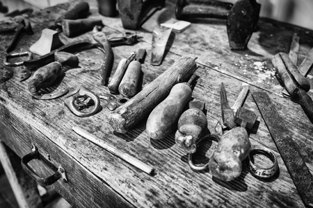 Detail of the wooden counter of a shoemaker.