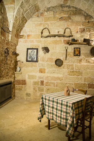 Lecce, Italy - August 10, 2014: Interior of an old stone farmhouse in Puglia. Editorial