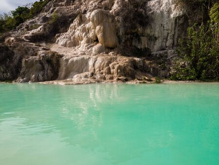 Natural swimming pool with thermal spring water in Bagno Vignoni, Italy. Stock Photo