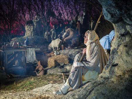 Villaga, Italy - December 30, 2017: Leprous dressed in rags during a historical re-enactment in the caves of Villaga, Italy.