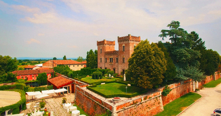 Verona, Italy - July 15, 2018: Beautiful old italian castle hosting wedding in the countryside. Aerial view.