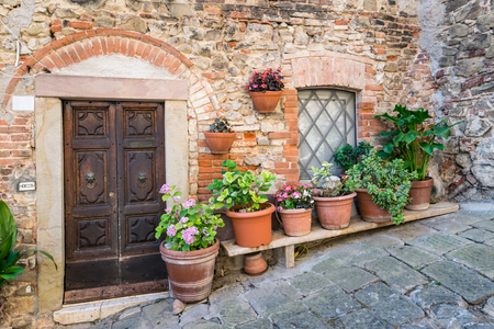 Detail of stone houses in an alley of an ancient Tuscan village in central Italy.
