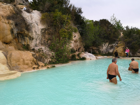 Natural swimming pool with thermal spring water in Bagno Vignoni, Italy. Editorial