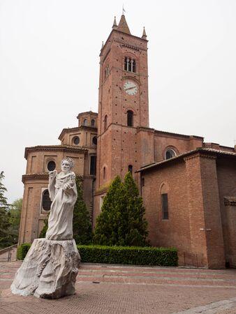 Abbey of Monte Oliveto Maggiore and white statue of Saint Bernardo Tolomei.