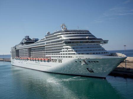 Civitavecchia, Italy - August 18, 2019: Luxury cruise ship docked at Civitavecchia port, the most important port close Rome, Italy.