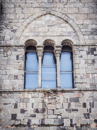 Triple lancet window of Italian medieval cathedral. Stock Photo