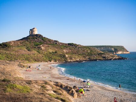 Sunset beach of San Giovanni di Sinis (Sardinia) and in the background the old tower.