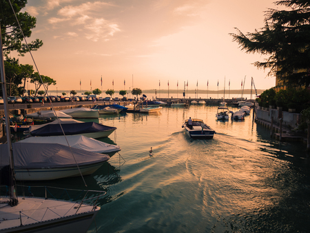 Sirmione, Italy - August3, 2017: Sunset on the small touristic port of Sirmione, Lake Garda, Italy.