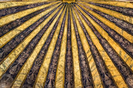 Detail of the gold decorated ceiling of an ancient church in the Italian Gothic-Renaissance style.