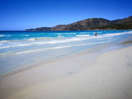 Blue and transparent water and the light sand of a beach in Sardinia. 版權商用圖片