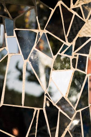 Texture formed by mosaic of pieces of black glasses 版權商用圖片