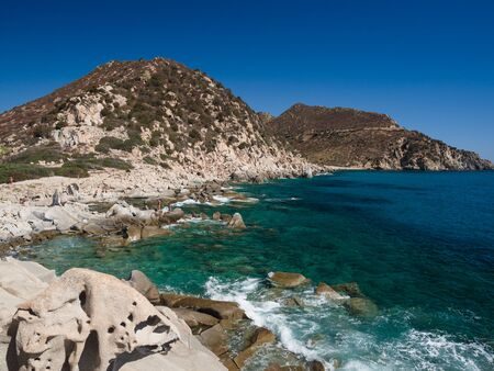 Rocky beach formed by large stones in the north of Sardinia, Italy. 版權商用圖片