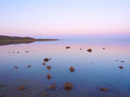 Notteri Pond famous for the presence of pink flamingos at dusk. Sardinia, Italy. 版權商用圖片