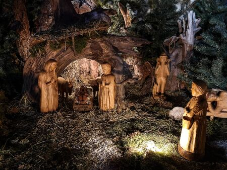 Ossana, Italy - December 26, 2019: Nativity scene made with hand-carved wooden figurines.