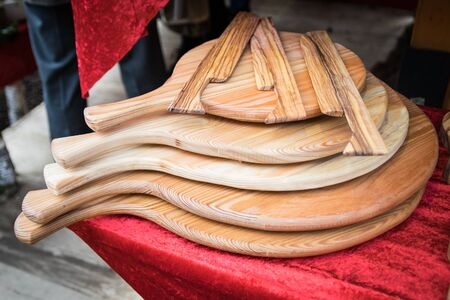 Handmade wooden cutting boards and wooden knives for spreading.