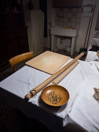 Wooden tools for homemade pasta in an old kitchen of an Italian village.