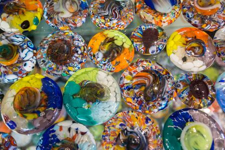 Background formed by circles of colored glass.