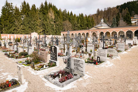Innichen, Italy - December 25, 2016: Innichen cemetery with characteristic wrought iron crosses.