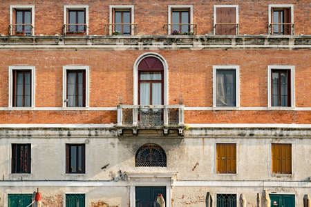Venice, Italy - April 23, 2017: Historic buildings on the banks of the grand canal in Venice.
