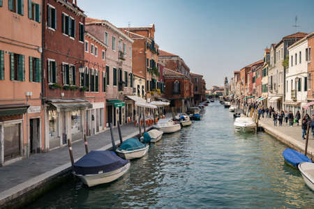 Murano, Italy - April 23, 2017: Main canal of Murano, an island that is part of the Venice lagoon.