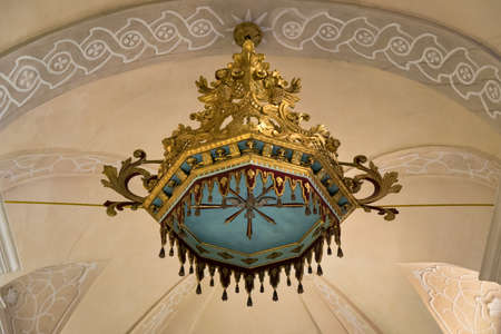 Marostica, Italy - April 12, 2016: Decoration hanging from the ceiling of an ancient church. 新聞圖片