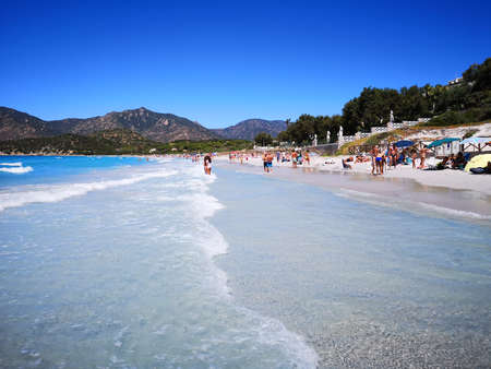 Villasimius, Italy - August 14, 2019: Blue and transparent water and the light sand of a beach in Sardinia.