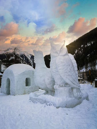 Pejo, Italy - December 23, 2019: Giant ice sculptures depicting an owl and a black grouse.