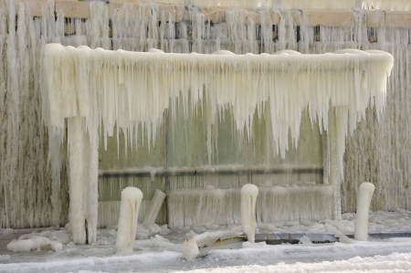 wintriness: Frozen breakwater and bus stop after winter storm in Varna, Bulgaria  Stock Photo