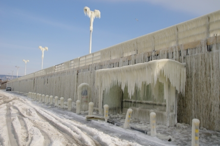 iciness: Frozen breakwater and bus stop after winter storm in Varna, Bulgaria  Stock Photo
