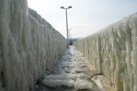 wintriness: Frozen breakwater after winter storm in Varna, Bulgaria