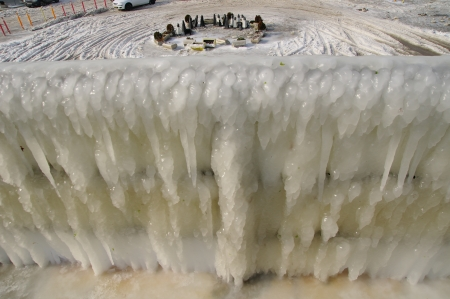 iciness: Frozen breakwater and plaza after winter storm in Varna, Bulgaria