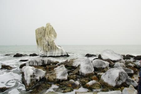 wintriness: Frozen rock near the Seaside Stock Photo