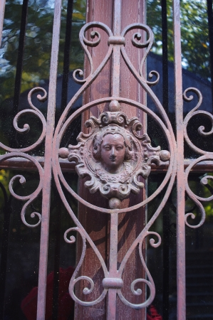 Female face of wrought  ironwork from Saint Giulio island in Orta lake photo