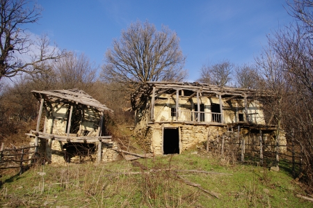 surviving: The last surviving houses abandoned village Dyulya, Bulgaria Stock Photo