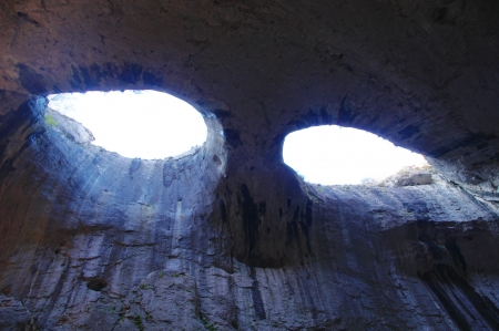 eyes cave: Karst cave Prohodna, Karlukovo, Bulgaria Stock Photo