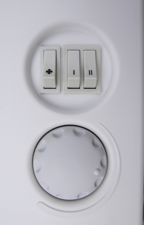 Knobs and thermostat on a electric stove photo