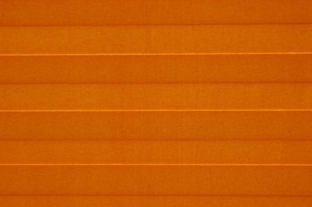 swelter: Orange sunblind  on sunny window Stock Photo