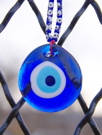 talism�n: Ojo azul talism�n contra el mal de ojo Foto de archivo