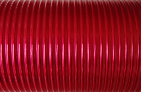 Close up of corrugated red old thermos photo